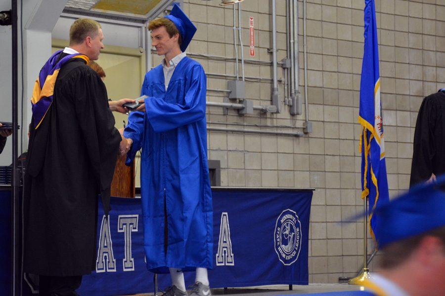 Senior Jared Becker receiving his diploma