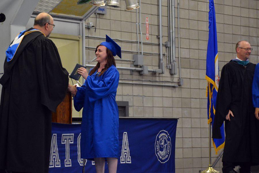Senior KeeLee Hoffstatter receiving her diploma