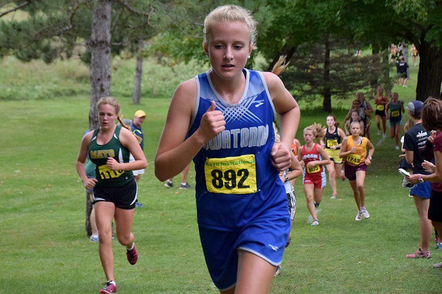 Freshman Olivia Larson running