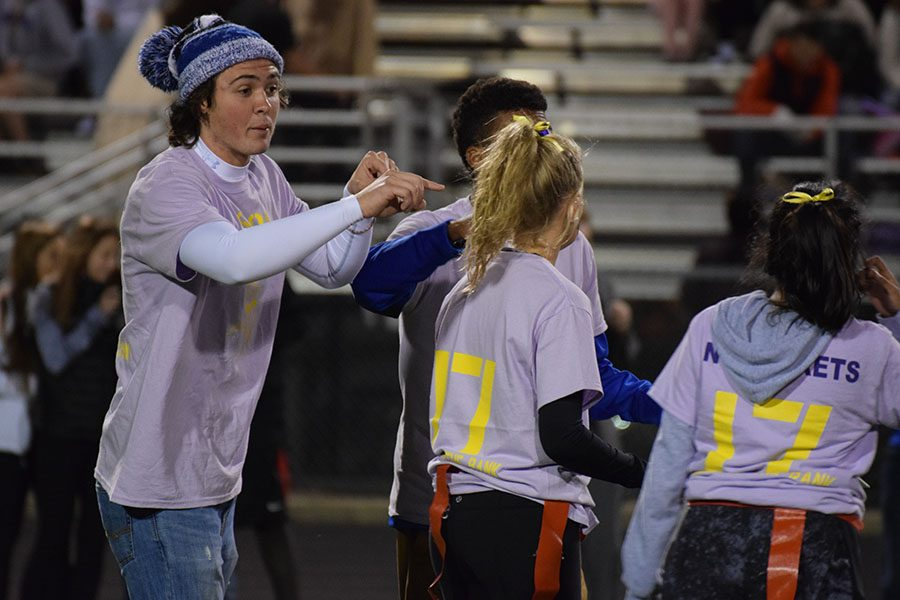 Coach Jake Menden and Coach Jadyn Gunderson giving some tips during the game