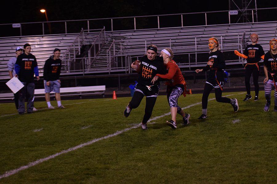 Junior Kenzie Karsten runs through the defender
