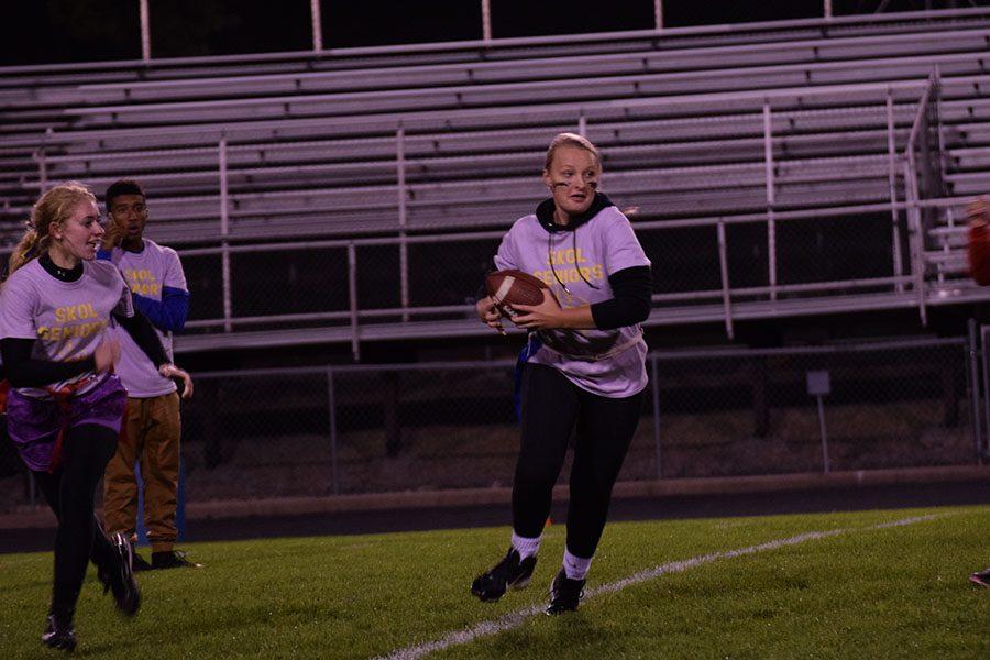 Senior Breanna Miller running the ball