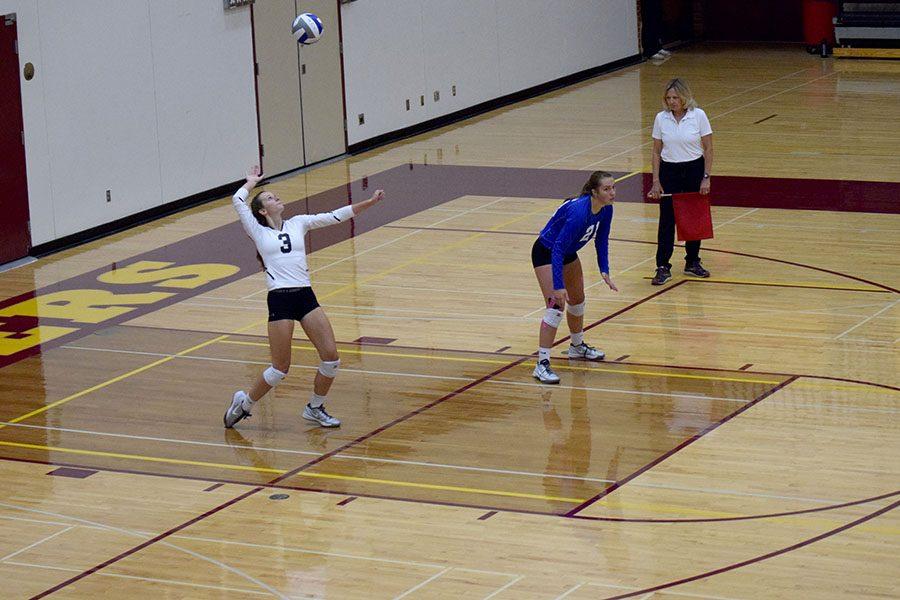 Senior Tori Urch serving the ball