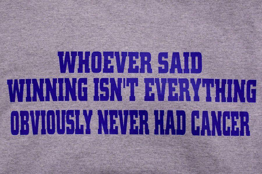 Back of Owatonna Huskies sack cancer t-shirt