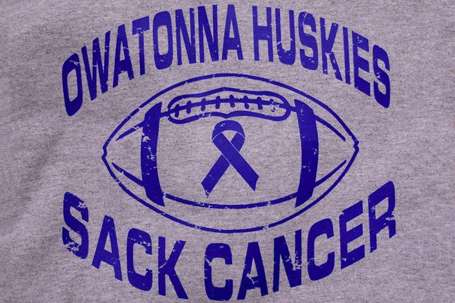 Front of Owatonna Huskies sack cancer t-shirt