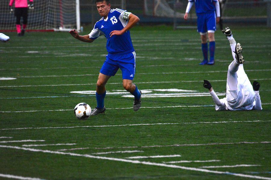 Senior Mitchell Mayer looks to make a pass up field