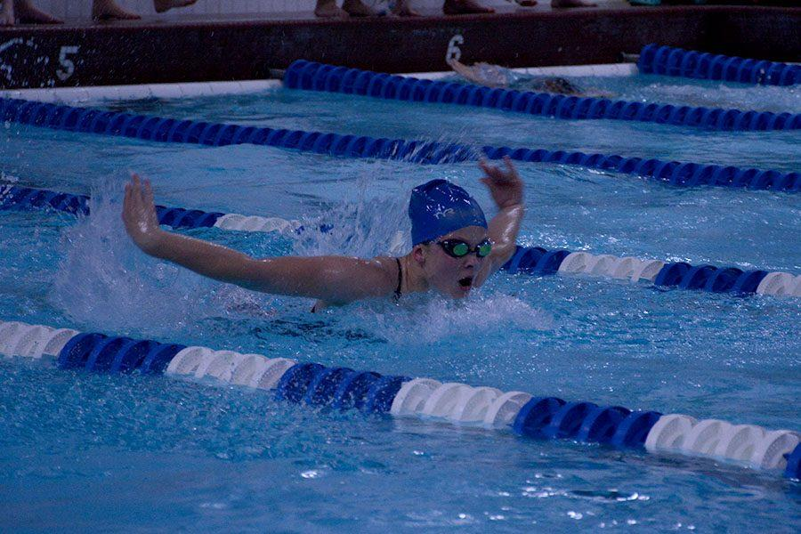 Junior Erica Svenby Competing in the 100 meter butterfly stroke