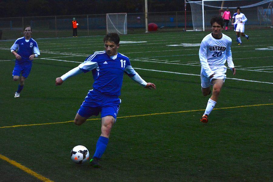 Senior Dan Keller kicking the ball up field