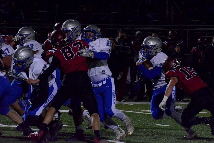 Sophomore Jason Williamson runs the ball