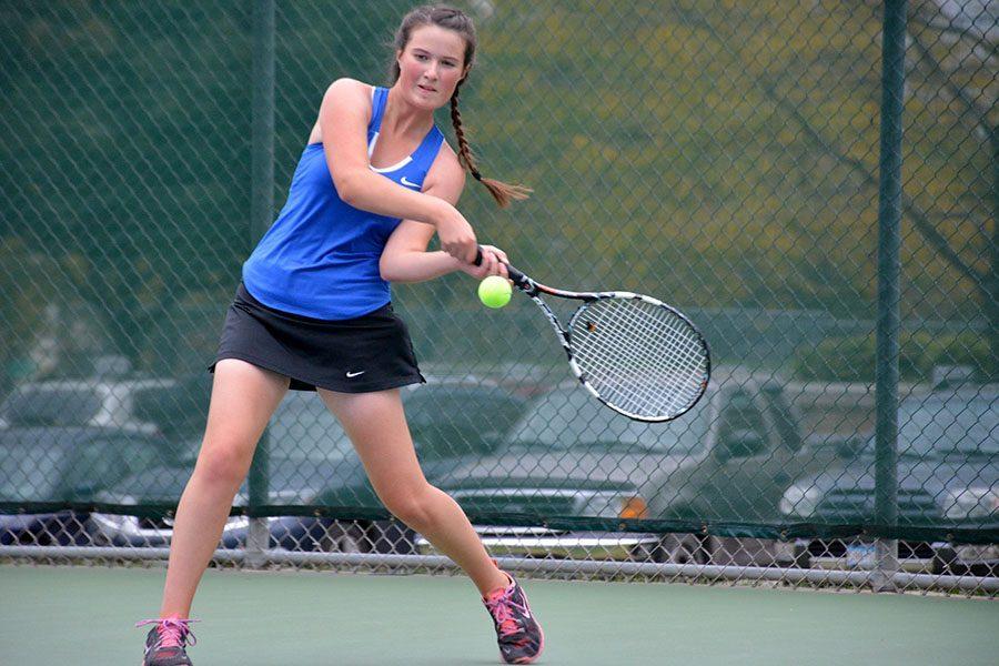 Junior Alissa Weide hitting the ball