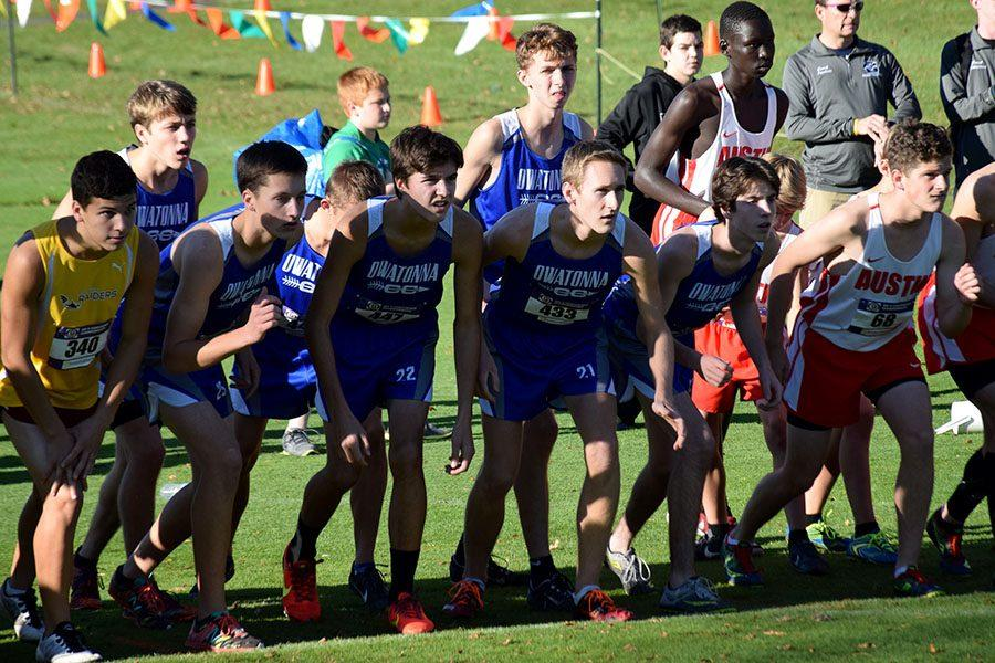 Owatonna's boys cross country team lining up before the race starts