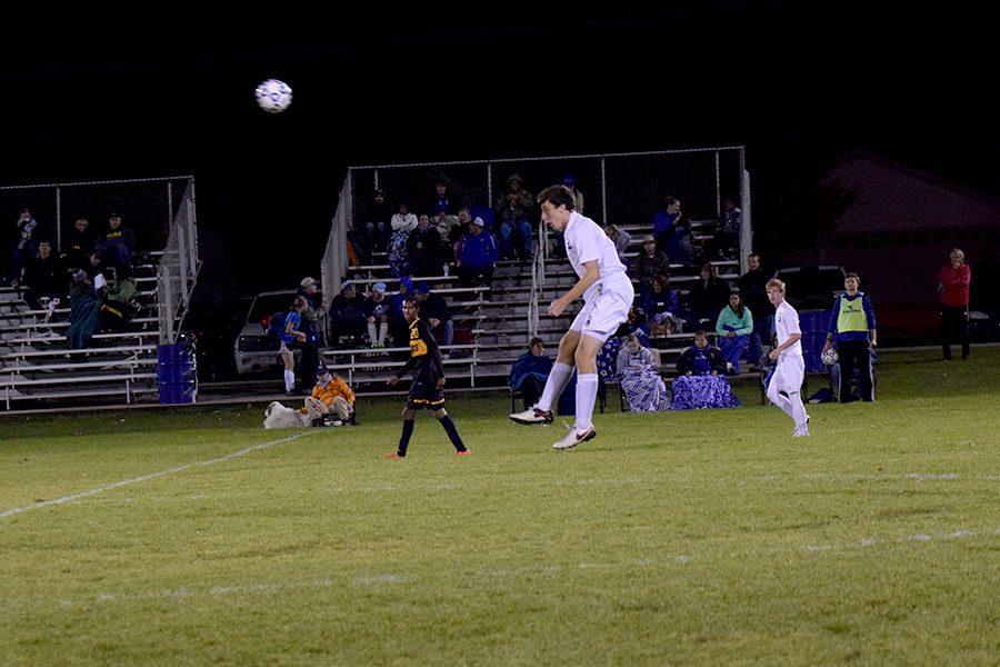 Junior Zach Kraus heading the ball