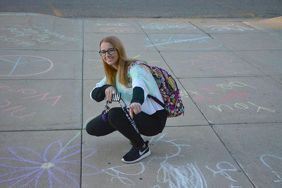 Junior Amelia Schultz posing for her favorite chalk.