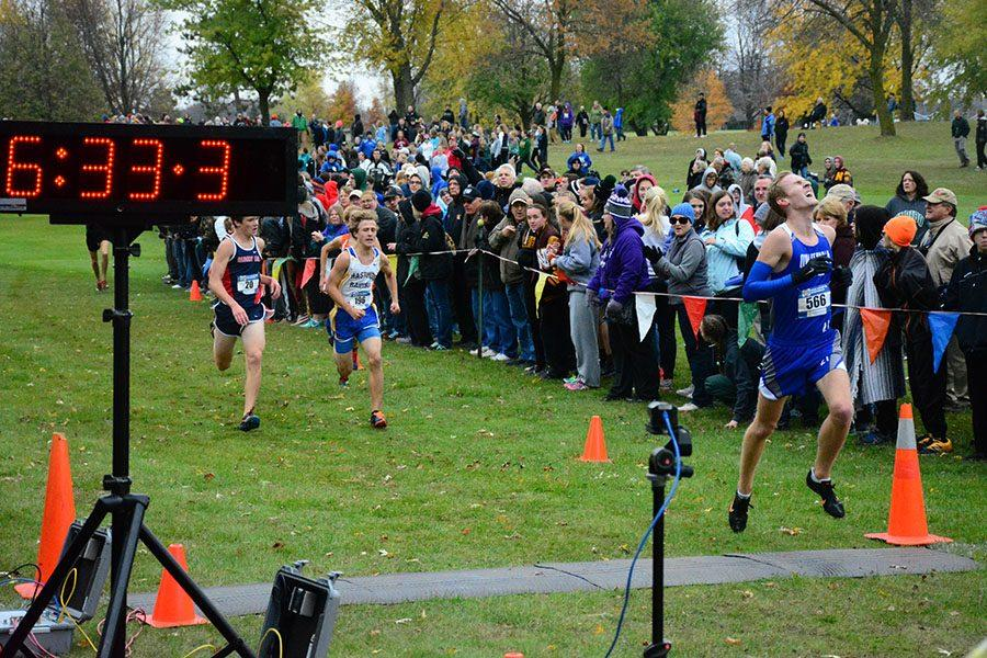 Kubat crosses the finish line and qualifies for the State Tournament