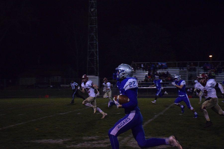 Sophmore Jason Williamson runs down the sideline.
