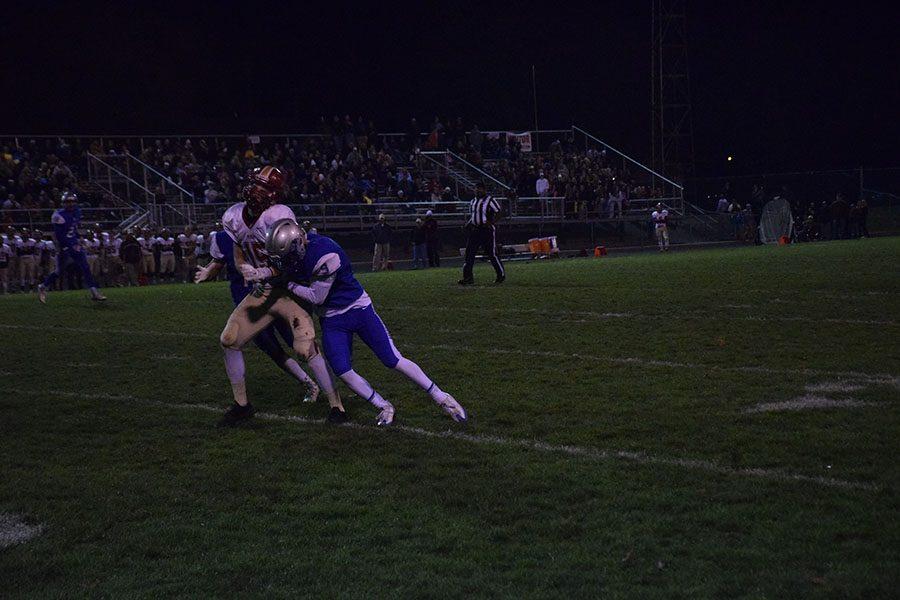 Senior Jaden Dowhaniuk tackles Northfield player.