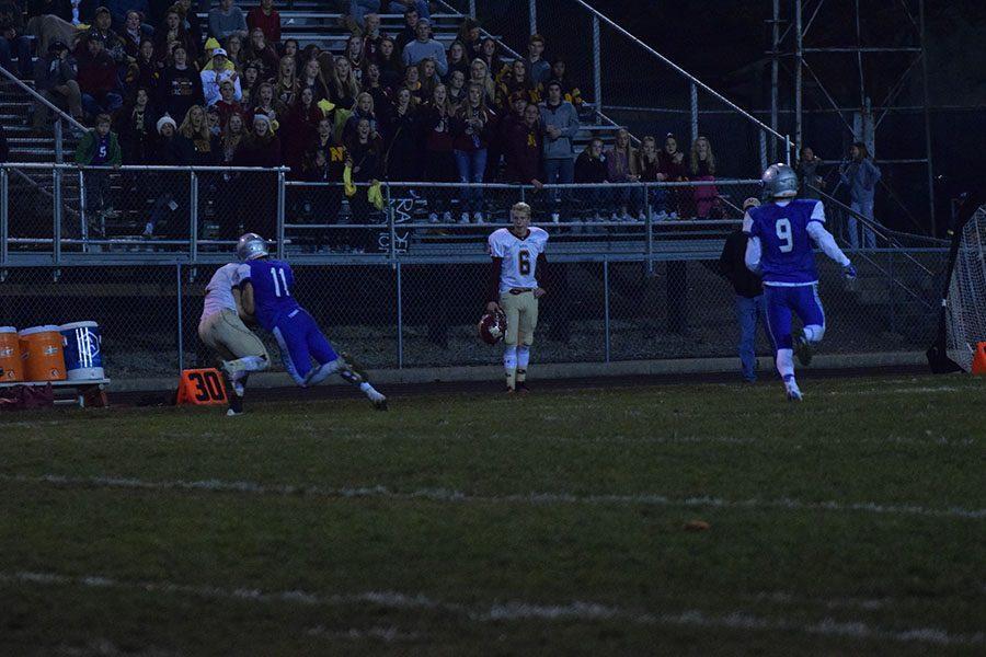 Senior Captain Brett Solie tackles Northfield player.