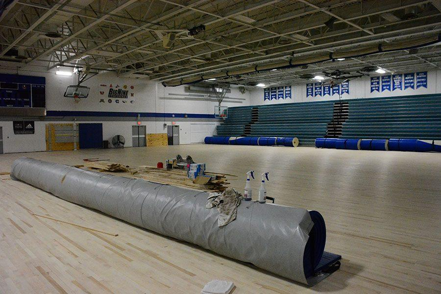 The unfinished gym floor and ready for College and Career Fair