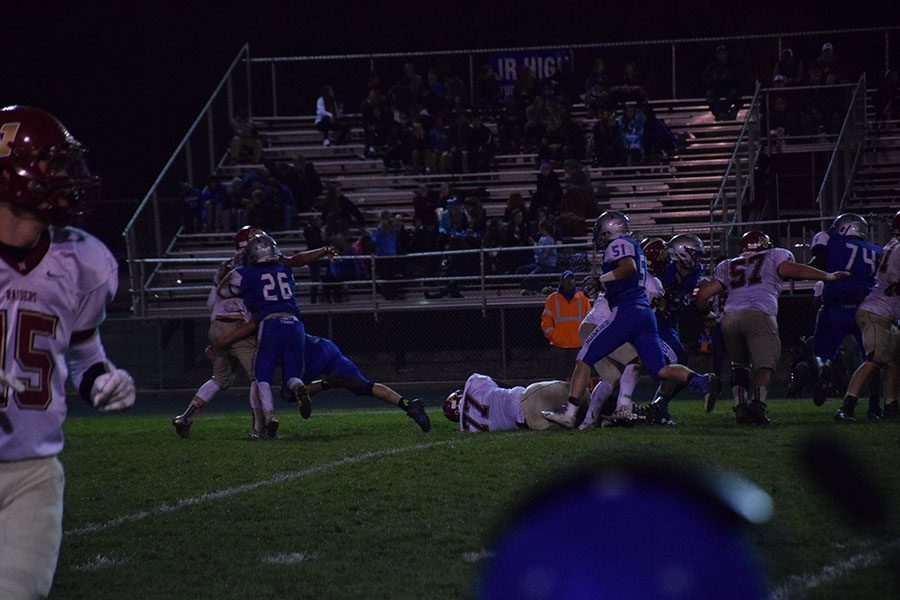 Junior Mitch Weise tackles QB.