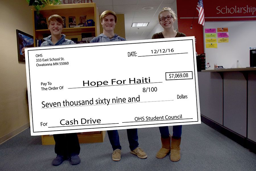 This years Cash Drive raised $7,069.08 for Hope For Haiti.  Pictured are Anna Weisenburger, Nick Sande, and Elena Dant - the Cash Drive chairs