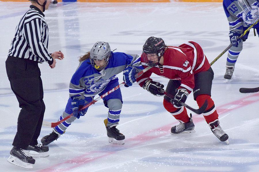 Maylynn Prokopec takes a faceoff at center ice