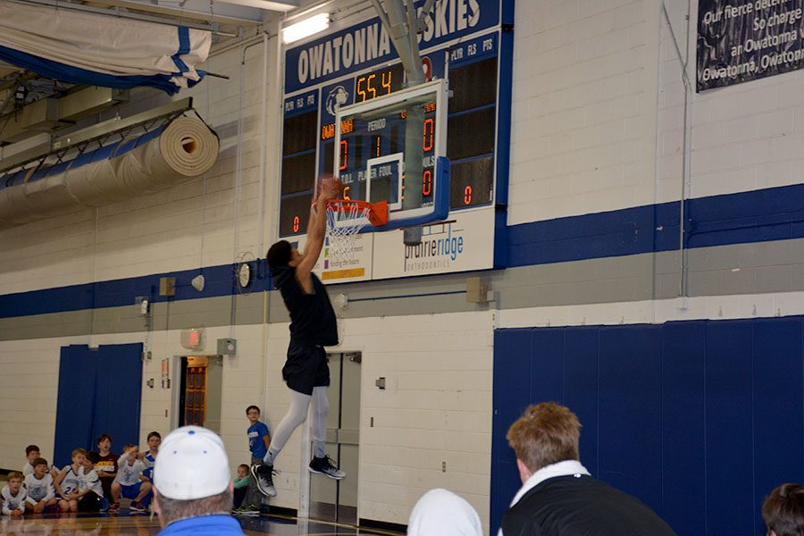 Owatonna's junior Andrew Jackson throws down a slam dunk at the first annual Husky Havoc Night.
