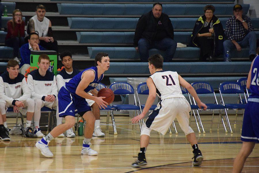 Junior Alex Raichle brings the ball up the floor
