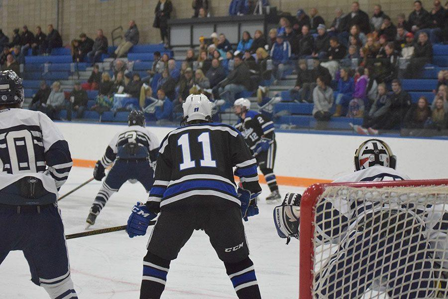 Junior Nick Smith looks to screen the St. Francis goalie