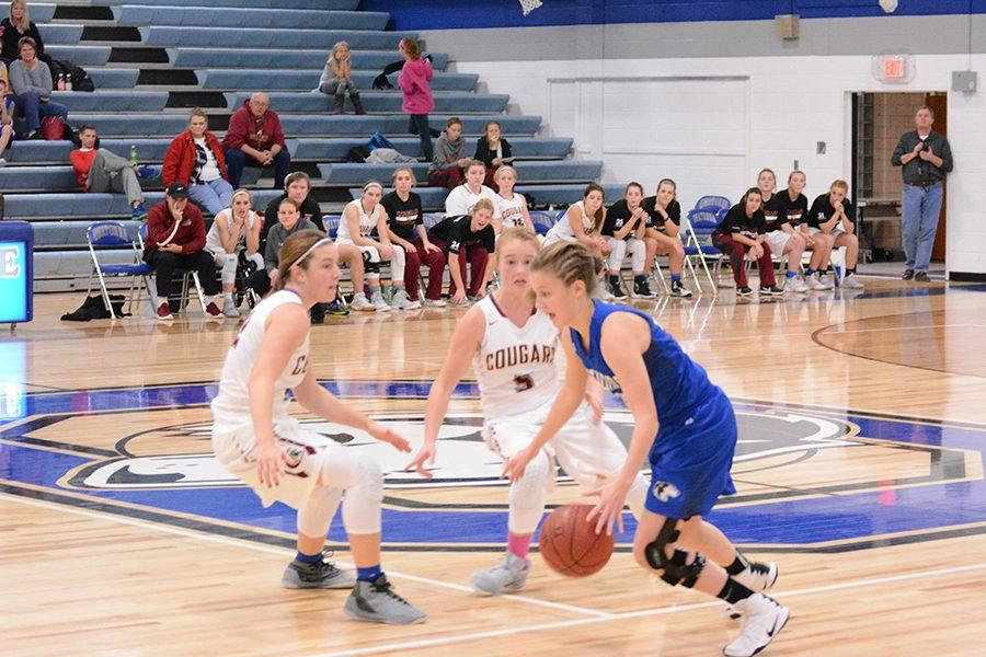 Junior Jenna Zeman dribbles past defenders