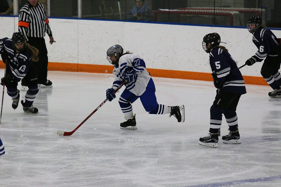 Sophomore Maylynn Prokopec attacks with the puck