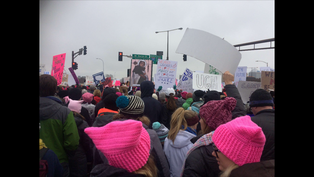 Women hold up signs in protest