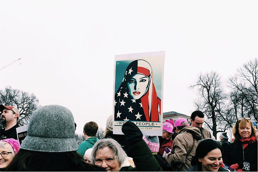 A woman holds up sign