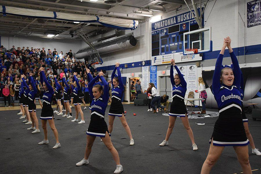 The cheerleading squad shows school spirit for the pep fest