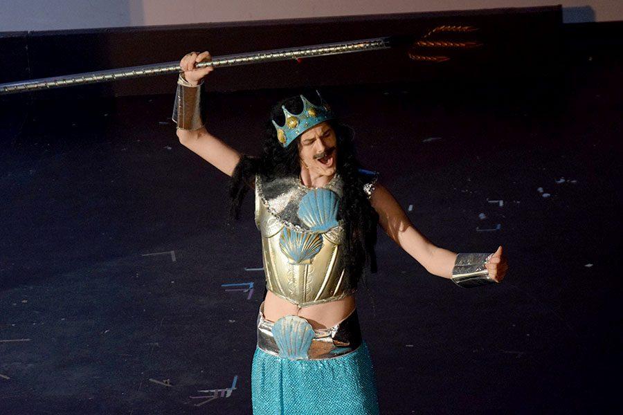 King Triton (Ian Crum) prepares to punish Ariel for visiting the human world