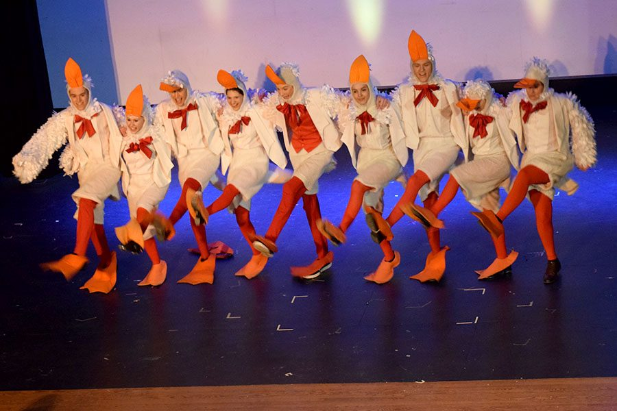 Scuttle (Evan Peterson) and his seagull friends dance