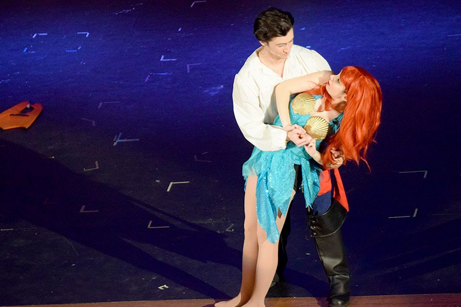 Prince Eric (Nicholas Hagen) rescues Ariel (Jenna McMains) on the shore