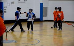 Sam Mullenbach and Zach Sencer talk between plays during the floor hockey game.
