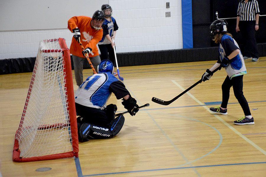 Nolan Engelbertson makes a save during the game.