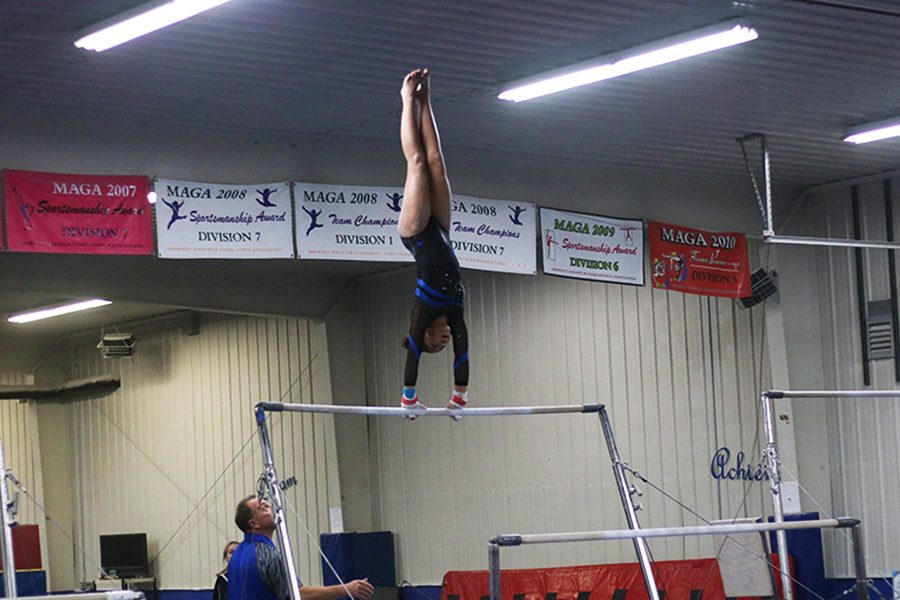 Janessa Moore hits a handstand