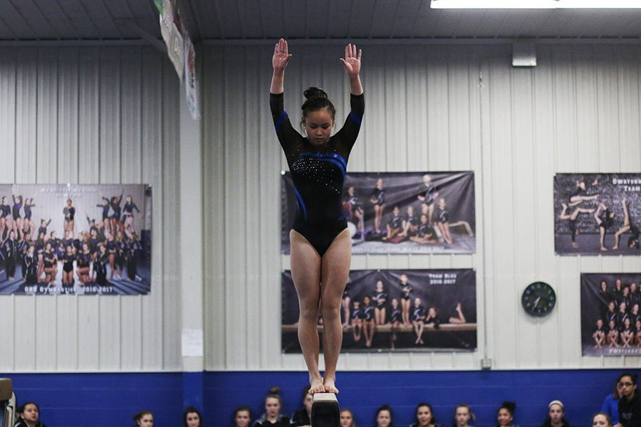 Allison An preparing to do a back tuck