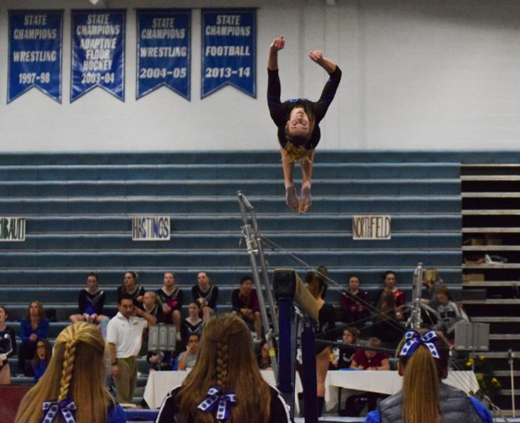 Syd Kretlow flips during her beam routine