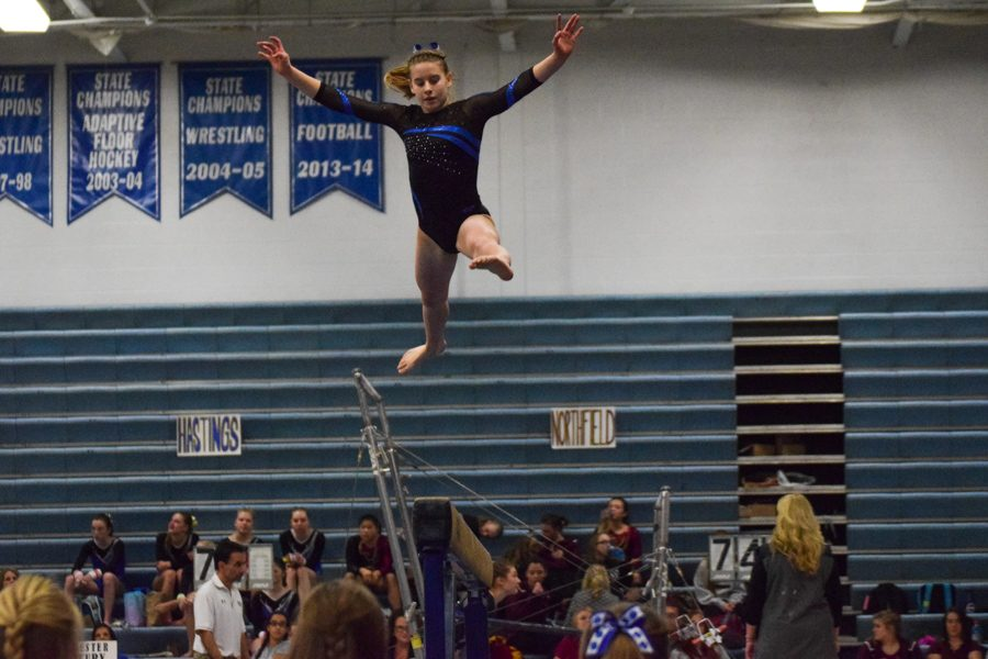 Lindsay Bangs leaps off of the beam