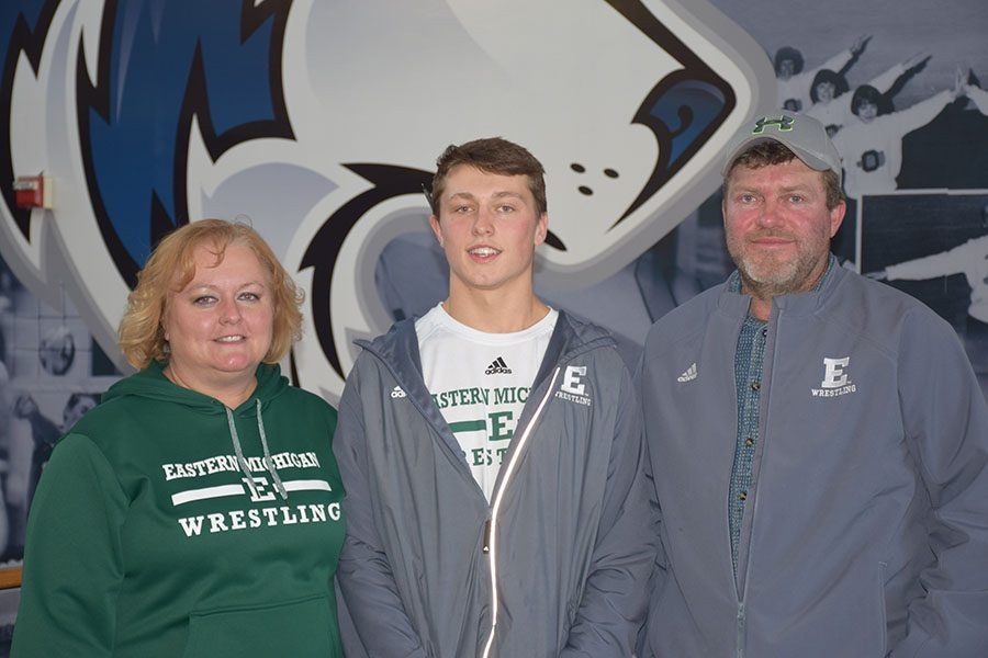 Brandon Moen posing with his parents