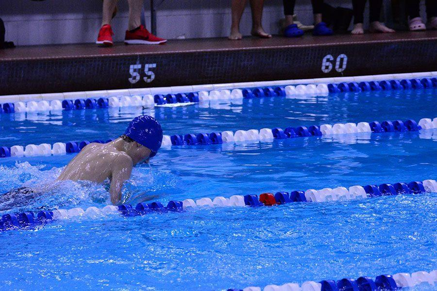 Sophomore Carter Khuen swimming the 100 yard breaststroke