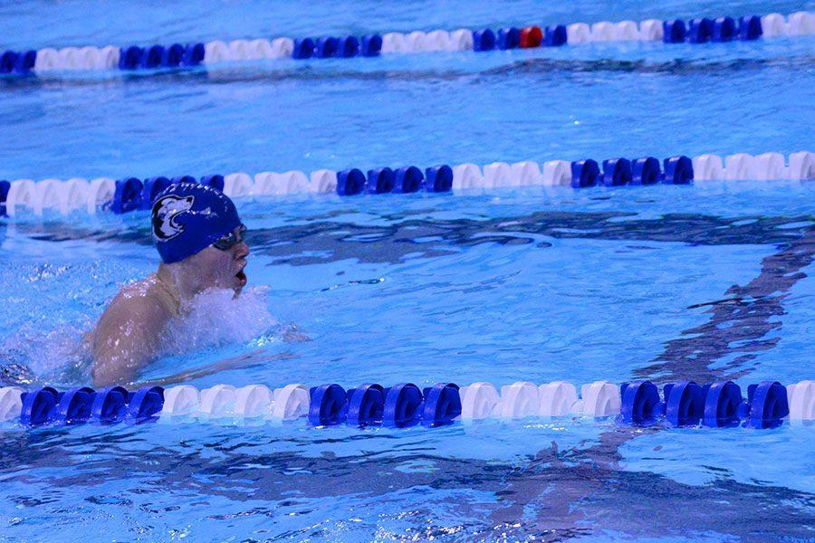 Sophomore Payton Jorgenson swimming the breaststroke in the 200 IM