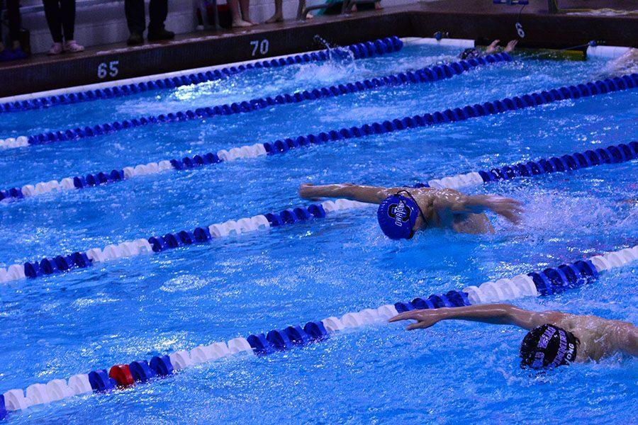 Junior Josh Belting Swimming the 100 yard butterfly