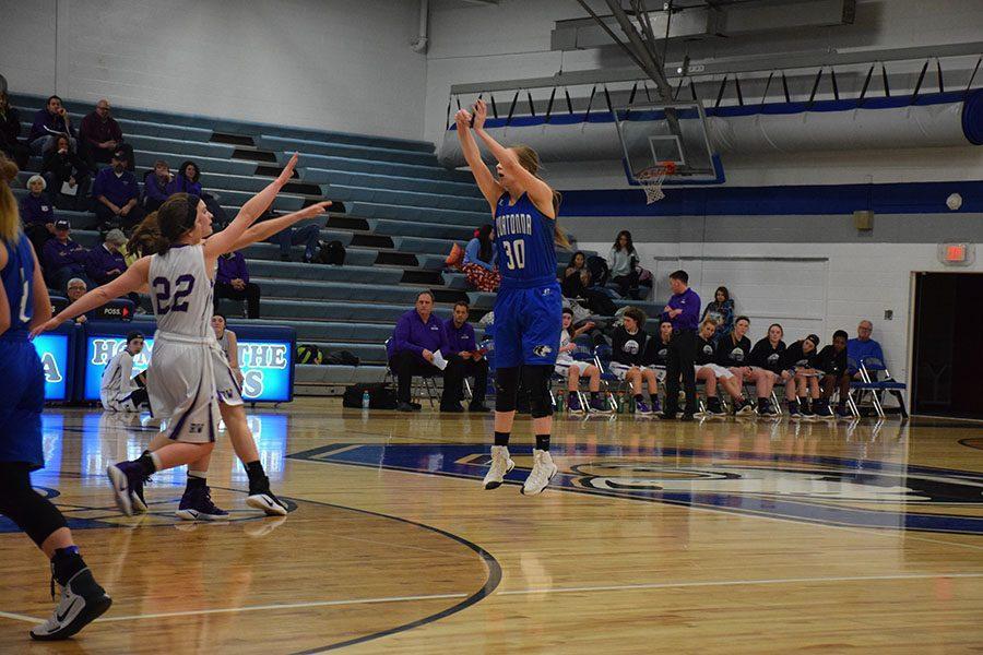 Junior Jenna Zeman shooting a 3-pointer