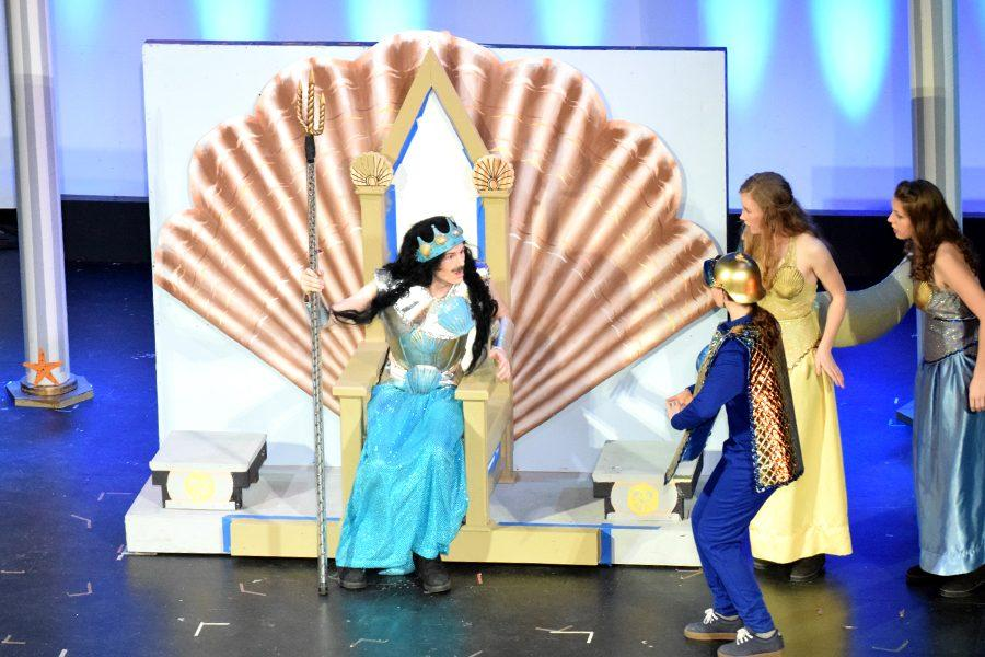 King Triton (Ian Crum) yelling at his servants to find his missing daughter, Ariel