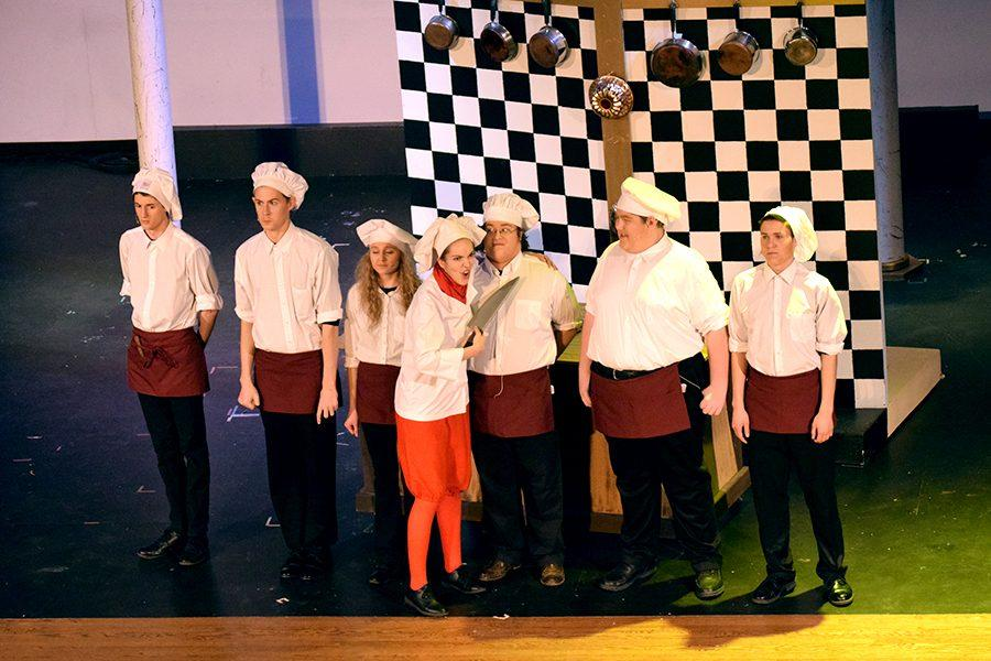 Chef Louis (Natalie Shroyer) threatens a group of his chefs.