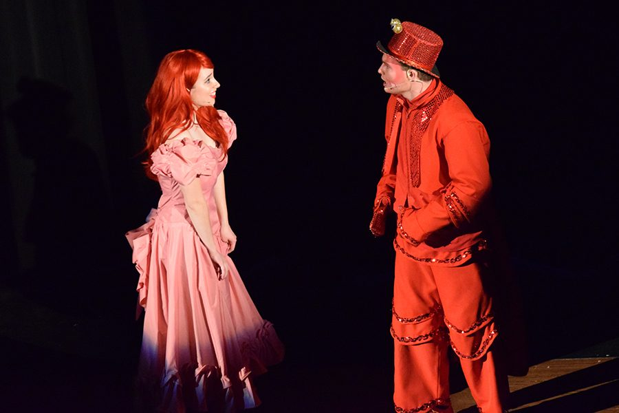 Sebastian (Andrew Wall) gives Ariel (Jenna McMains) some pointers on how to get Prince Eric to fall for her.